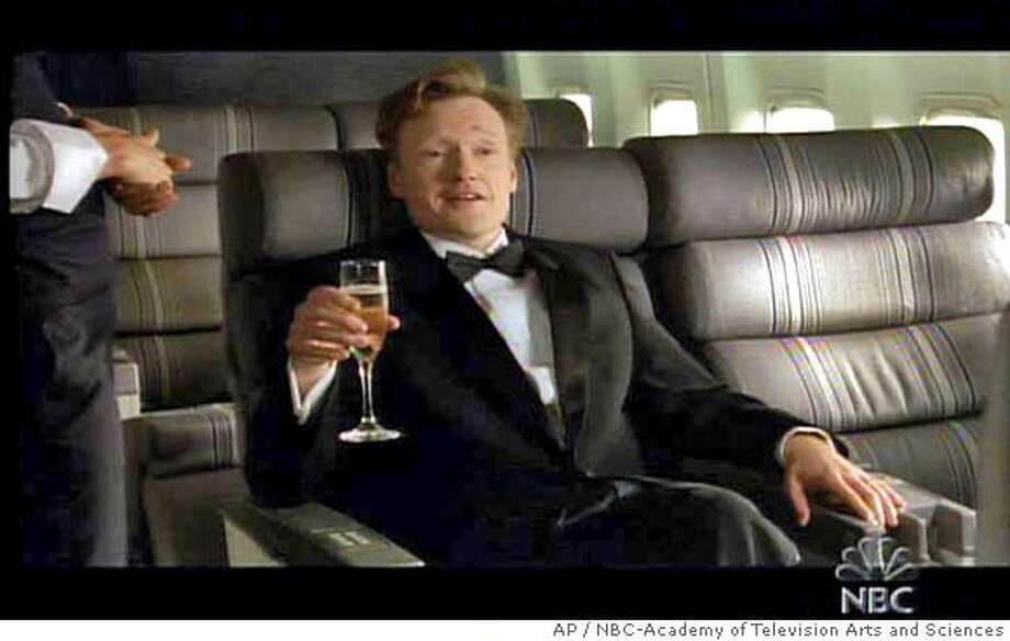 This still photo from video, supplied by NBC and the Academy of Television Arts and Sciences, shows Emmy Awards show host Conan O'Brien's opening gag -- a filmed comedy bit. The sequence prompted criticism that it was in bad taste following the fiery crash of a commuter jet earlier in the day in Lexington. Ky., that killed 49 people. (AP Photo/NBC-Academy of Television Arts and Sciences) SUPPLIED BY NBC-ACADEMY OF TELEVISION ARTS AND SCIENCES, , TV OUT,NOT FOR USE AFTER AUG. 29, 2006,NO ARCHIVES Photo: AP Photo
