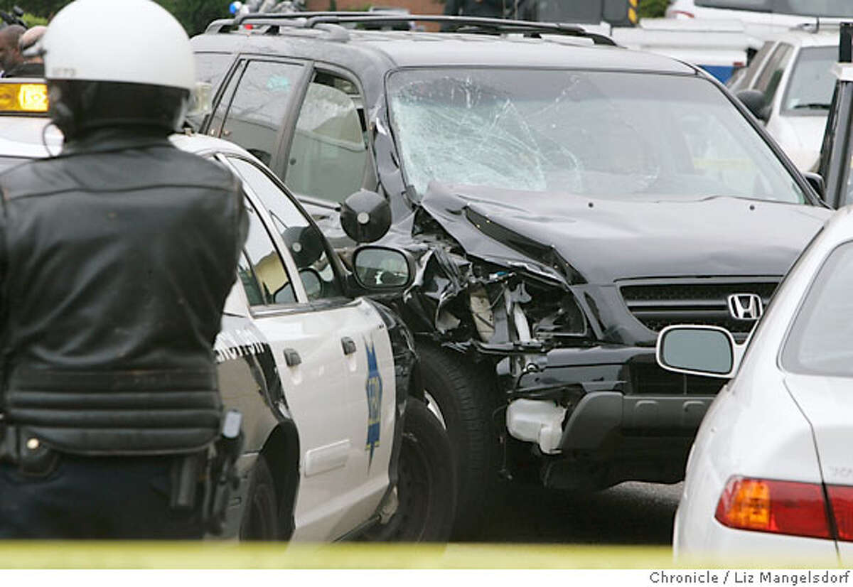 The suspect in a number of hit and run incidents in San Francisco, abandoned his vehicle, with a smashed front, on Spruce Street at California in San Francisco on Aug. 28, 2006 Liz Mangelsdorf /The Chronicle