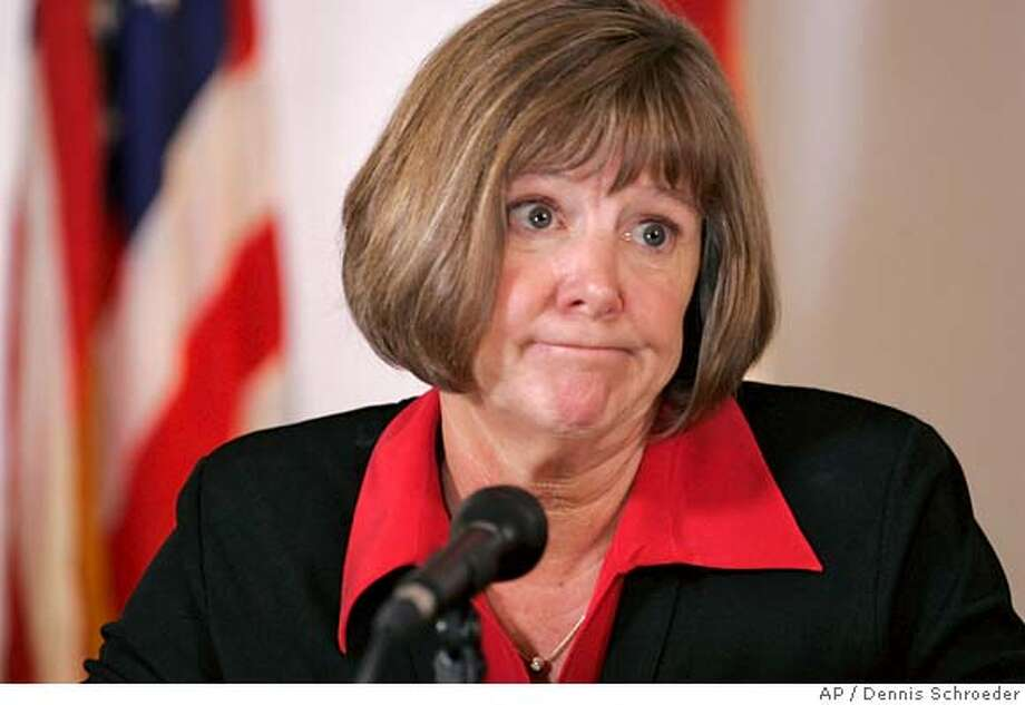 Boulder County District Attorney Mary Lacy ponders a question during a news conference at the Justice Center in Boulder, Colo., on Tuesday, Aug. 29, 2006, about the arrest and dismissal of charges against John Mark Karr. (AP Photo/Dennis Schroeder,Pool) POOL PHOTO EDITORIAL USE ONLY Photo: DENNIS SCHROEDER