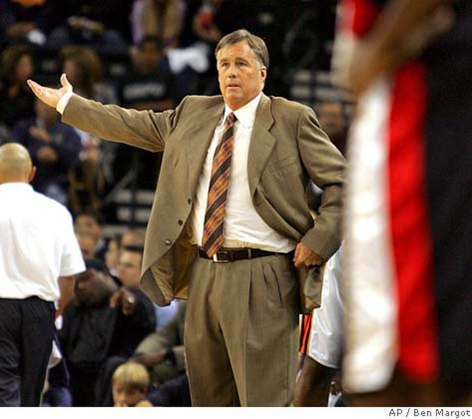 Golden State Warriors' coach Mike Montgomery gestures to his players during the first quarter against the Portland Trail Blazers Wednesday, Nov. 3, 2004, in Oakland, Calif. (AP Photo/Ben Margot) Ran on: 11-04-2004  Jason Richardson tries to get the ball away from a sprawled-out Derek Anderson as Shareef Abdur-Rahim joins in. Ran on: 10-24-2005 Ran on: 10-24-2005 Ran on: 10-24-2005 Photo: BEN MARGOT
