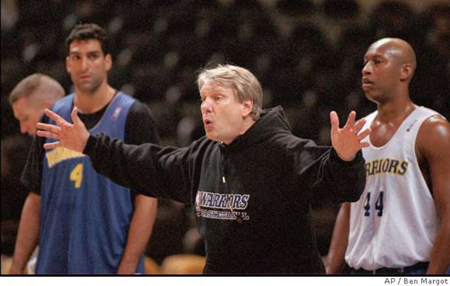 Golden State Warrior's head coach Don Nelson, flanked by Rony Seikaly, left, and Clifford Rozier, right, gestures during team practice Monday, Jan. 2, 1995, at the Oakland, Calif., Coliseum. This was Nelson's first appearance with the team since being hospitalized December 14 with viral pneumonia. Nelson hopes to coach his first game Tuesday night against San Antonio. (AP Photo/Ben Margot) CAT Photo: BEN MARGOT