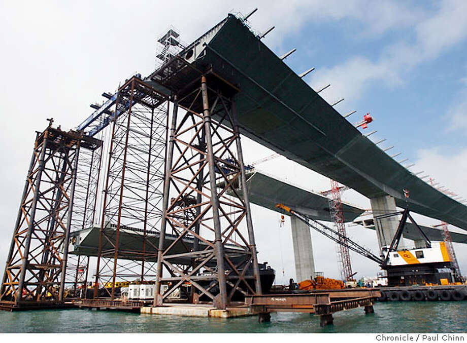 A 1,750 ton steel section of the westbound structure (lower left) was slowly lifted into place which will connect the skyway section to the Self-anchored Suspension section which has yet to be built. Construction work on the skyway section of the eastern span of the new Bay Bridge in Oakland, Calif. on Tuesday, August 29, 2006.  PAUL CHINN/The Chronicle Photo: PAUL CHINN