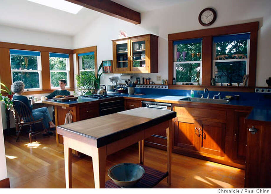 Joanna Lynch's kitchen in Oakland, Calif. on Wednesday, August 23, 2006. Since contractor Blake Gilmore remodeled the kitchen 25 years ago, the two have been friends ever since and frequently get together for tea and pastries (left).  PAUL CHINN/The Chronicle  **Joanna Lynch, Blake Gilmore MANDATORY CREDIT FOR PHOTOGRAPHER AND S.F. CHRONICLE/ - MAGS OUT Photo: PAUL CHINN