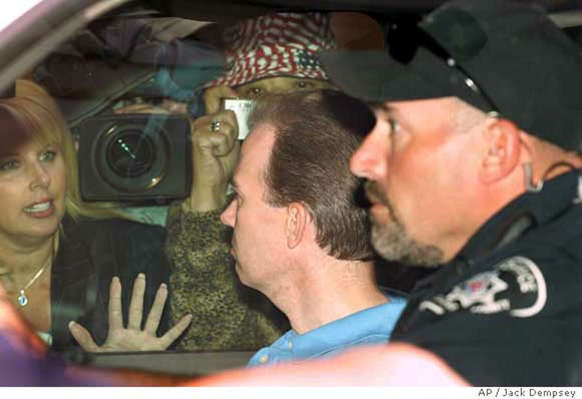 John Mark Karr, center, formerly a suspect in the decade-old JonBenet Ramsey murder, is transported back to the Boulder County Jail after charges against him were dropped by the district attorney Monday, Aug. 28, 2006, in Boulder, Colo. Prosecutors abruptly dropped their case against John Mark Karr in the slaying of JonBenet Ramsey, saying DNA tests failed to put him at the crime scene despite his repeated insistence he killed the 6-year-old beauty queen. (AP Photo/Jack Dempsey)