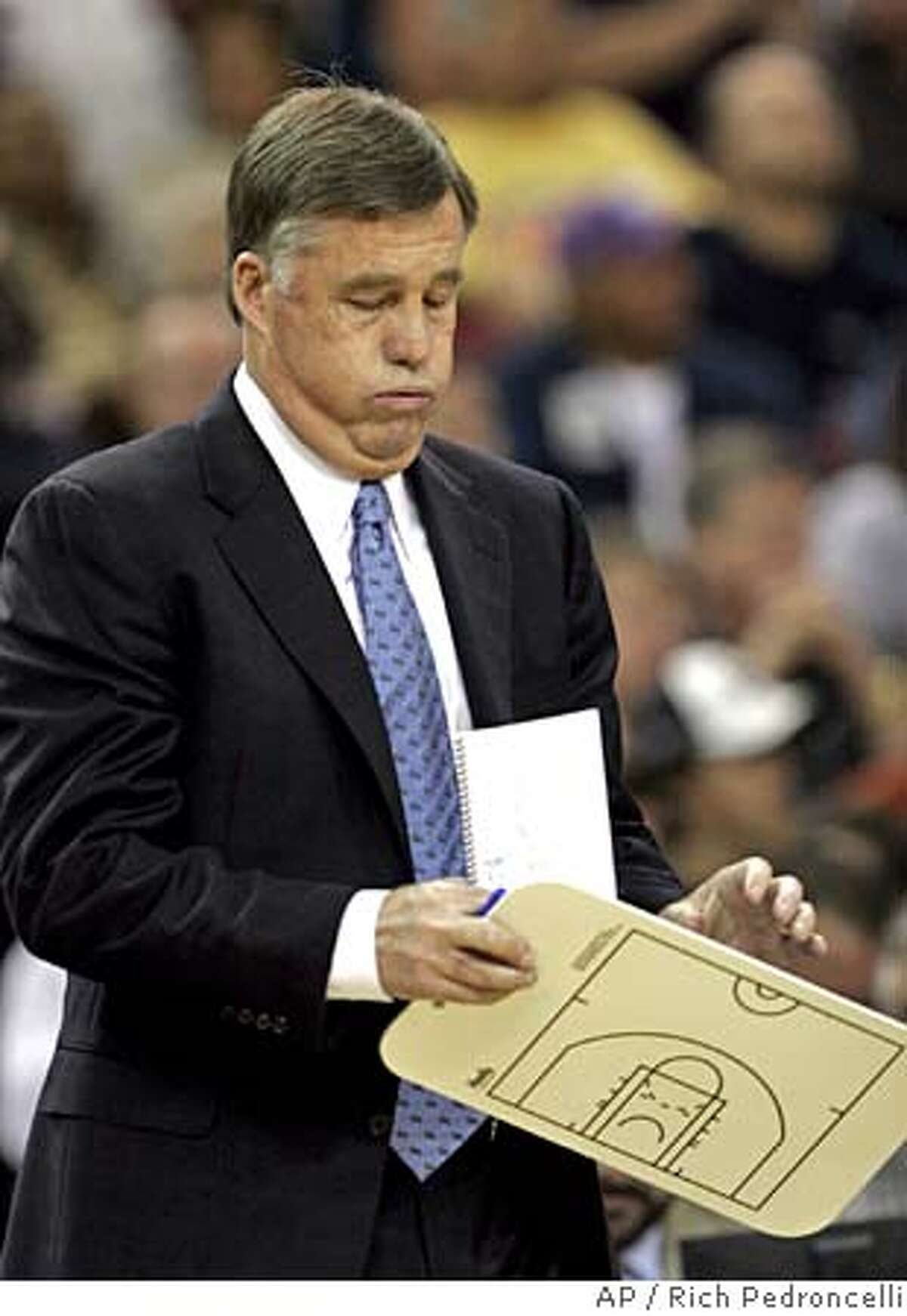 Golden State Warrors head coach Mike Montgomery sighs as he takes a time out in the fourth quarter of the Warrriors' 102-77 loss to the Sacramento Kings in an NBA basketball game in Sacramento,Calif., Tuesday, Feb. 21, 2006. (AP Photo/Rich Pedroncelli) EFE OUT