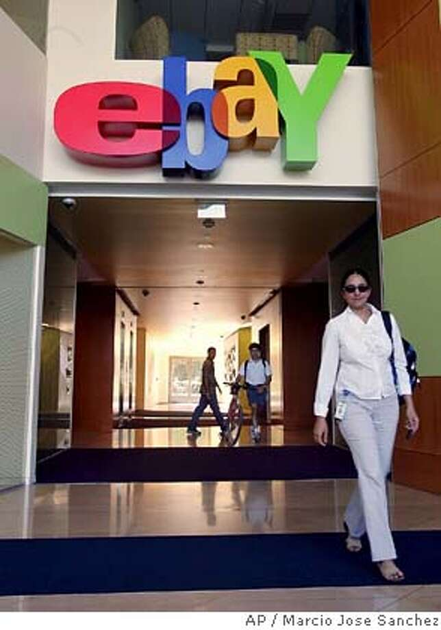 ** FILE ** Employees walks the halls at eBay headquarters in a San Jose, Calif. file photo from July 25, 2006. Google Inc. announced Monday that the search engine company will sell advertising for eBay outside the United States and help buyers connect to merchants, but it's unclear whether the deal will mean more choices or more confusion for millions of users. (AP Photo/Marcio Jose Sanchez, File) JULY 25, 2006 FILE PHOTO Photo: MARCIO JOSE SANCHEZ