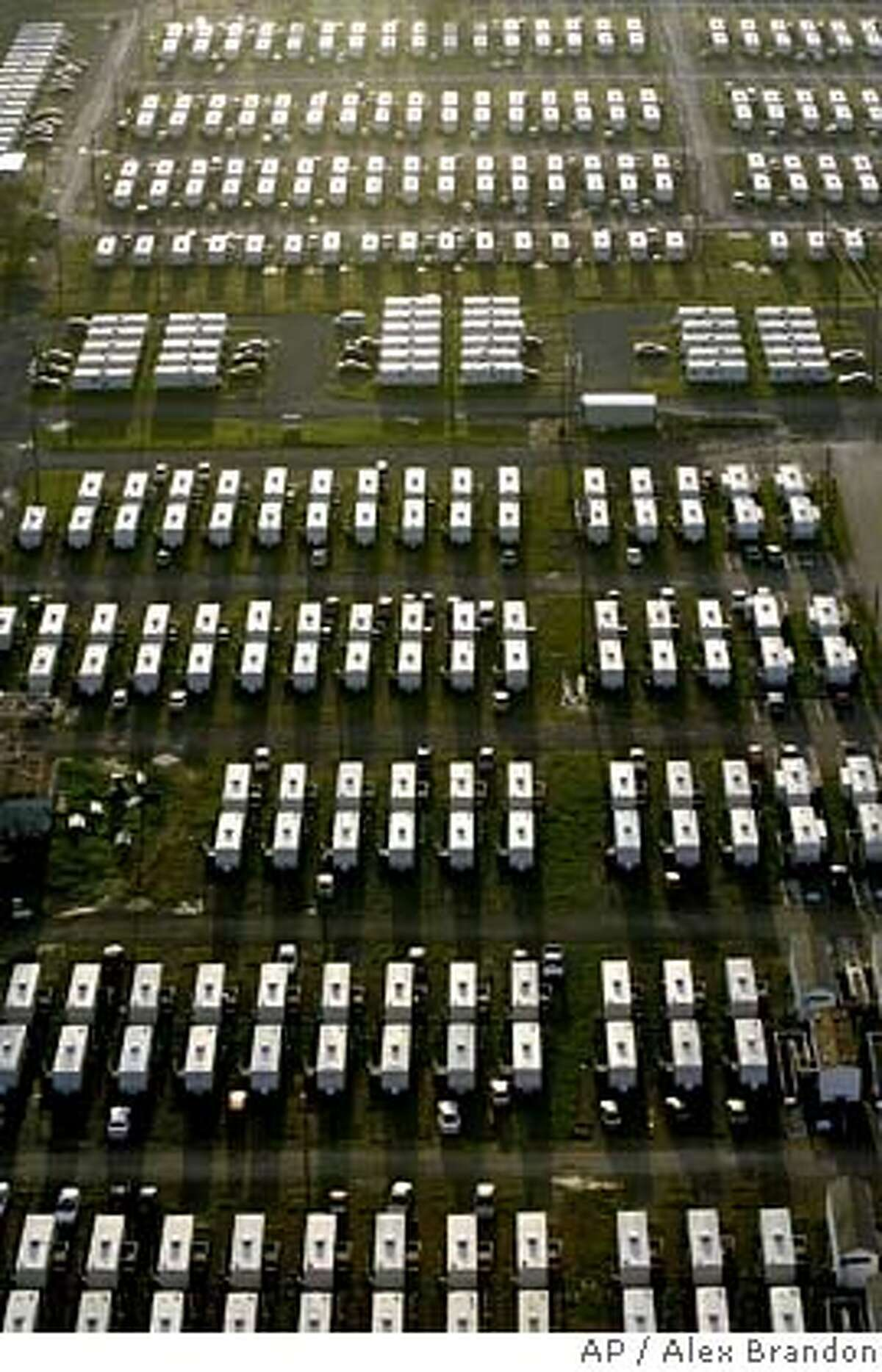 FEMA trailers that are being used for housing for University of New Orleans students and faculty are shown early Monday Morning in New Orleans, Monday, Aug. 28, 2006. Hurricane Katrina came ashore almost a year ago flooding much of the city. Members of Congress toured the city Monday and President Bush was headed for the region to see the state of recovery efforts one year after the city was ravaged by Hurricane Katrina. (AP Photo/Alex Brandon)
