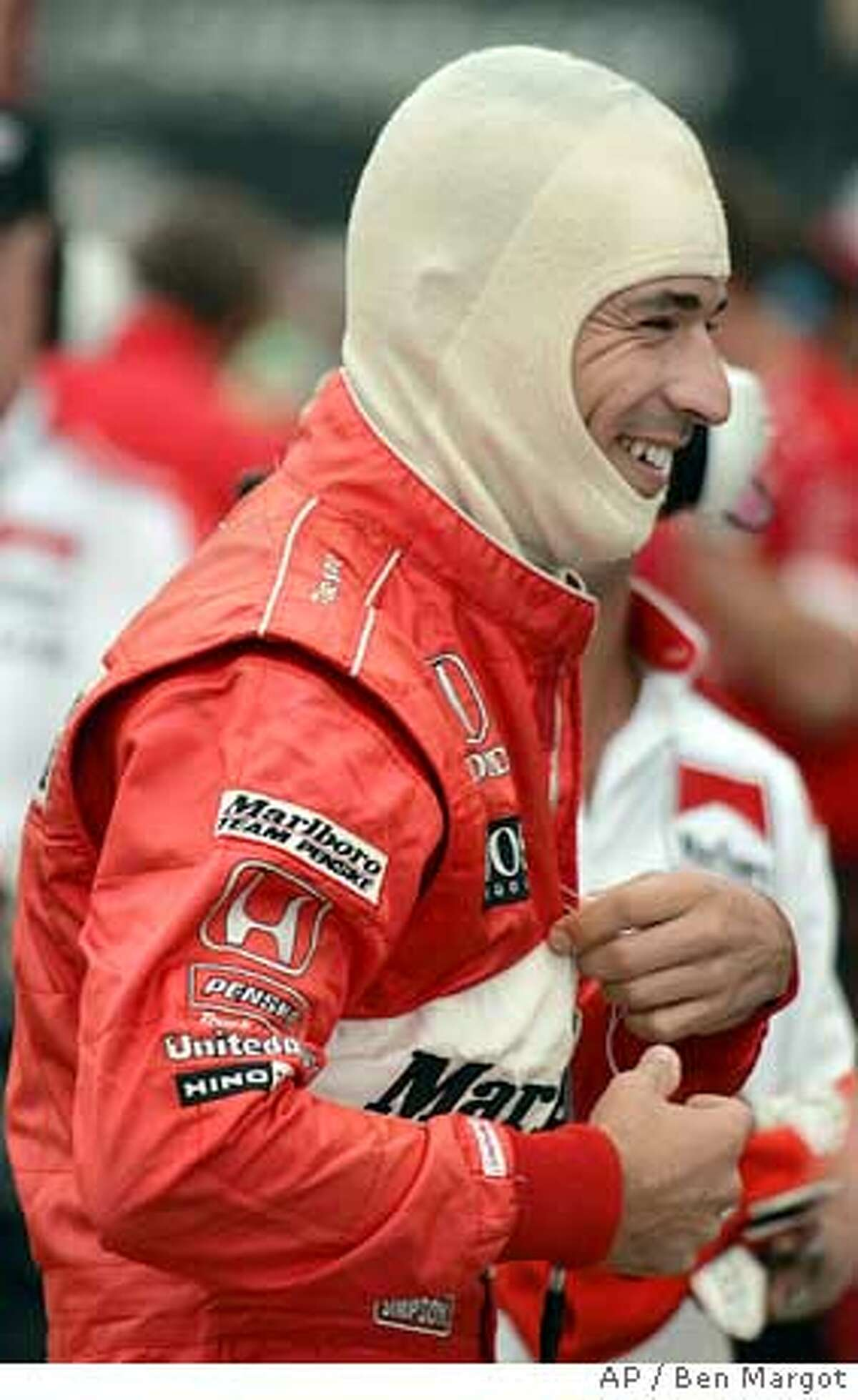 IRL driver Helio Castroneves of Brazil, smiles prior to taking practice laps for the Indy Grand Prix of Sonoma Friday, Aug. 25, 2006, at Infineon Raceway in Sonoma, Calif. (AP Photo/Ben Margot)