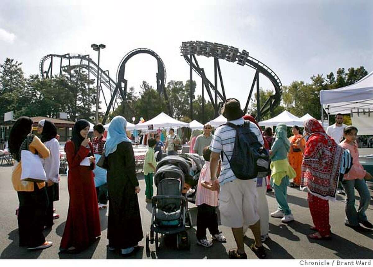 muslimunity149.jpg Muslim families gathered in a separate area of the park Sunday but were constantly reminded of the rides as the roller coaster
