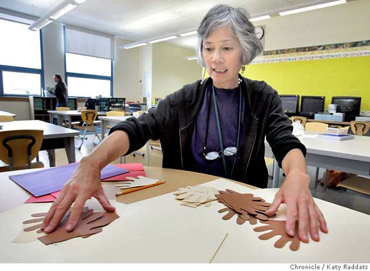 NEWSCHOOL28_086_RAD.jpg SHOWN: Third grade teacher Mae Rose Albert makes templates for people books for her incoming students. Story is about the new Dianne Feinstein Elementary School that will open on Monday. It's the first public elementary school to open in San Francisco in two years. These photos shot on Thursday, Aug. 24, 2006, in San Francisco, CA. (Katy Raddatz/The S.F.Chronicle) **Mae Rose Albert Ran on: 08-28-2006 Third-grade teacher Mae Rose Albert makes templates for her incoming students at the Dianne Feinstein Elementary School.