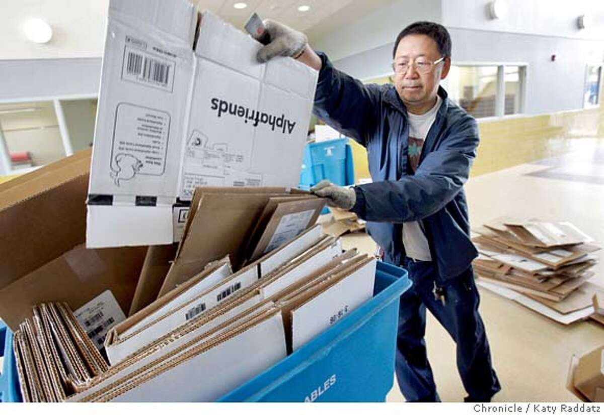 SHOWN: Custodian Paul Szeto recycles about a million cardboard boxes that held books for the school. Story is about the new Dianne Feinstein Elementary School that will open on Monday. It's the first public elementary school to open in San Francisco in two years These photos shot on Thursday, Aug. 24, 2006, in San Francisco, CA. (Katy Raddatz/The S.F.Chronicle) **Paul Szeto