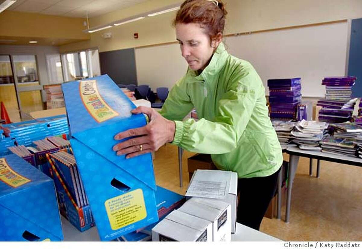 SHOWN: Liz Isaacs, whose son, Eli, will begin kindergarten on Monday, loads learning materials on a cart and will deliver them to classrooms. Liz is a parent who knows that schools need parental involvement. Story is about the new Dianne Feinstein Elementary School that will open on Monday. It's the first public elementary school to open in San Francisco in two years These photos shot on Thursday, Aug. 24, 2006, in San Francisco, CA. (Katy Raddatz/The S.F.Chronicle) **Liz Isaacs, Eli Isaacs