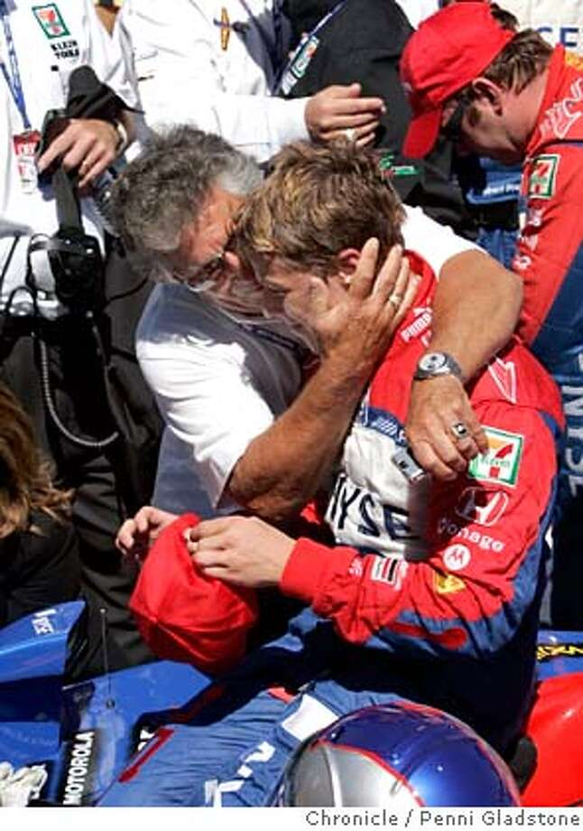 Mario Andretti goes for a hug to congratulate his grandson Marco Andretti in the winners circle after winning the Indy Car Grand Prix of Sonoma, IRL race at Infineon Raceway. Event on 8/27/06 in Sonoma.  Penni Gladstone / The Chronicle  ***cq Cardinale MANDATORY CREDIT FOR PHOTOG AND SF CHRONICLE/ -MAGS OUT Photo: Penni Gladstone
