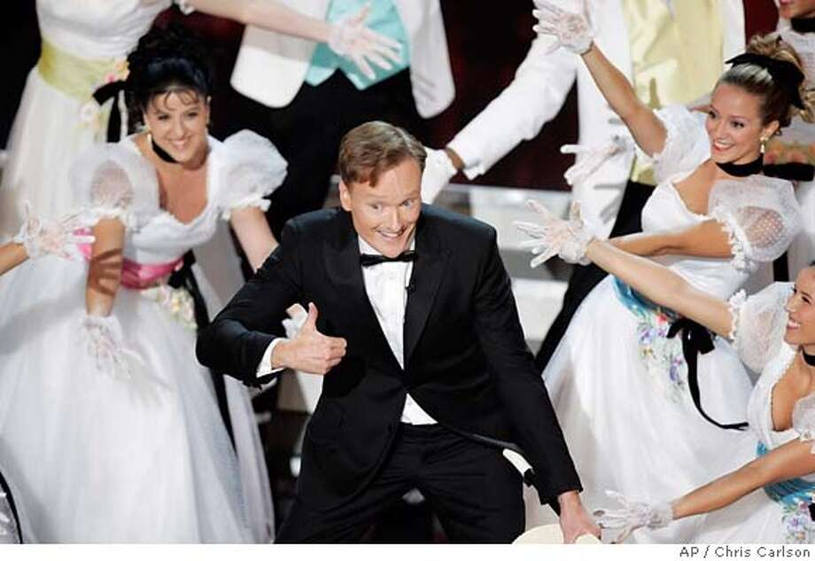 Host Conan O'Brien performs with dancers to open the 58th Annual Primetime Emmy Awards Sunday, Aug. 27, 2006, in Los Angeles. (AP Photo/Chris Carlson) Photo: CHRIS CARLSON