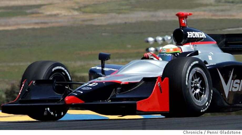 IRL28  car #2, You can see the hand of driver Tomas Scheckter of Vision Racing as he races along in this Indy Car Grand Prix of Sonoma, IRL race at Infineon Raceway. Event on 8/27/06 in Sonoma.  Penni Gladstone / The Chronicle  *cq race report official box score MANDATORY CREDIT FOR PHOTOG AND SF CHRONICLE/ -MAGS OUT Photo: Penni Gladstone