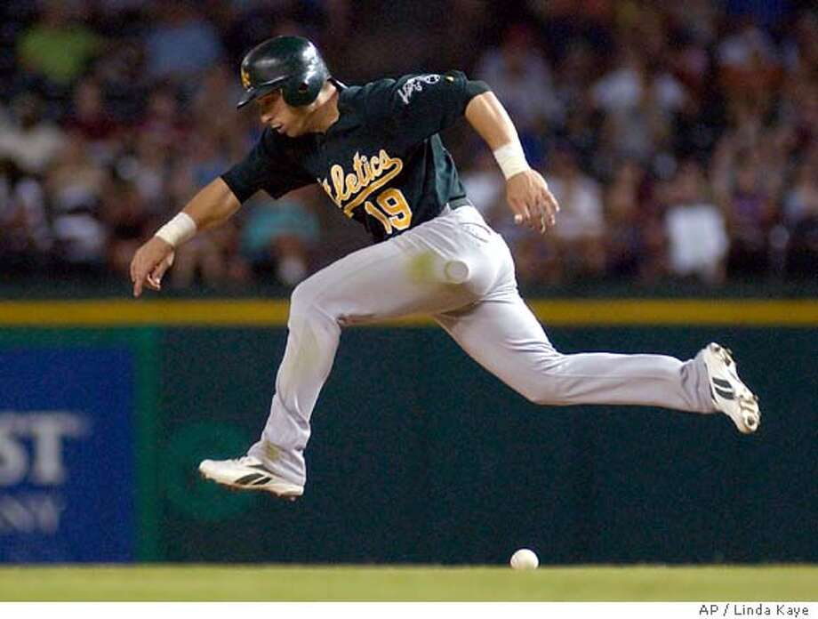 Oakland Athletics' Marco Scutaro leaps over a single to right field hit by Mark Ellis off a pitch from Texas Rangers' Wes Littleton in the eighth inning of a baseball game in Arlington, Texas, Saturday, Aug. 26, 2006. The Athletics won 5-3. (AP Photo/Linda Kaye) Photo: LINDA KAYE