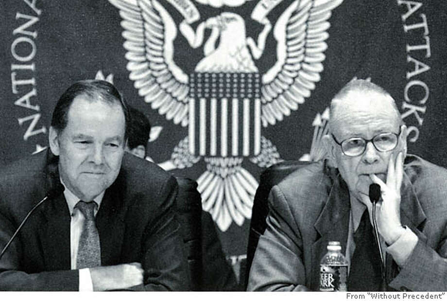 """Tom Keane (left) and Lee Hamilton, co-chairs of the 9/11 Commission and co-authors of """"Without Precedent,"""" preside over the final hearing in 2004. Photo from """"Without Precedent"""""""