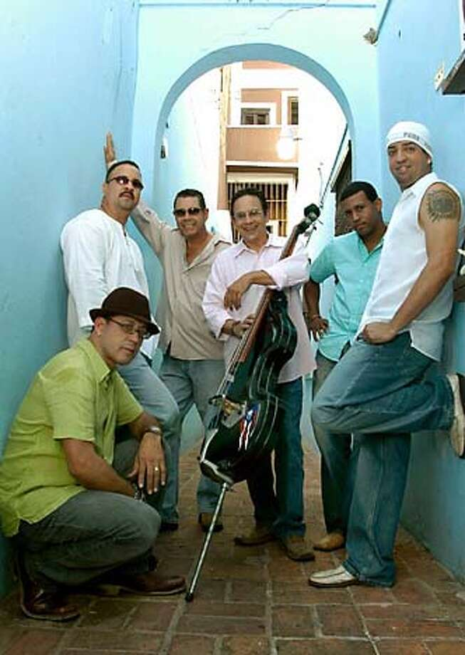 "6 members of 12-piece PLENA LIBRE from Puerto Rico  ""Evoluci�n"" CD release Oct 4, 2005 and tour  photo by Rosario Fernandez press contact: Cindy Byram  212-545-7536 X 21  CindyByram@AOL.com Photo: Rosario Fernandez"