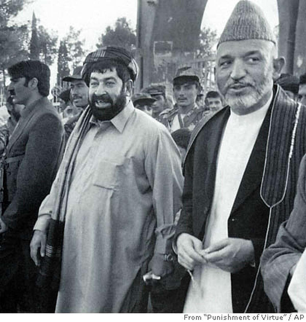 Afghan President Hamid Karzai (right) and Gul Agha Shirzai