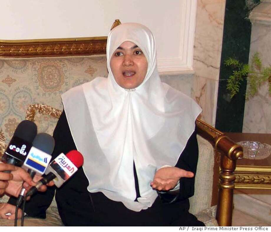 "In this photo released by the Iraqi Prime Minister Press Office, Iraqi kidnapped Sunni lawmaker Tayseer al-Mashhadani talks to the media after meeting the Iraqi Prime minister, soon after her release, in Baghdad, Iraq, Saturday Aug. 26, 2006. Al-Mashhadani was seized July 1, 2006 by gunmen in a Shiite Shaab area of north Baghdad as they were traveling from nearby Diyala province to attend a parliament session the following day. She was freed Saturday after being held for nearly two months, and the prime minister described her release as a ""gift"" on the day he launched his project for national reconciliation.(AP Photo/Iraqi Prime Minister Press Office, HO) PHOTO PROVIDED BY THE IRAQ PRIME MINISTER PRESS OFFICE Photo: AP"