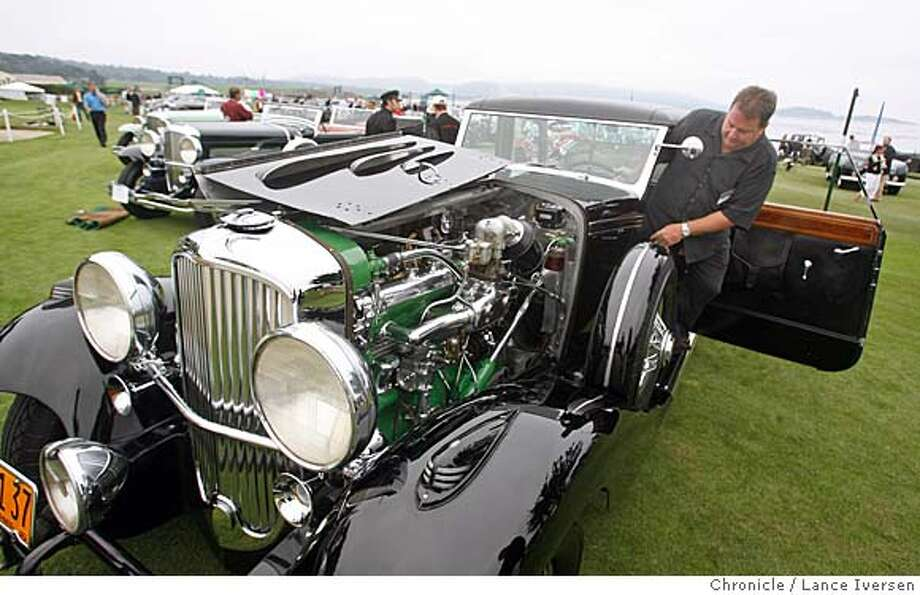 MOTORXXconcours_0422.JPG  Mark Lange from Lodi Ca climbs into his 1936 Duisenberg Rollston powered by the original straight eight. The 56th annual Pebble Beach Concours d'Elegance held on the 18th fairway of Pebble Beach draws thousands of car enthusiasts to the annual event. AUGUST 19, 2006 in PEBBLE BEACH. By Lance Iversen/San Francisco Chronicle Photo: By Lance Iversen