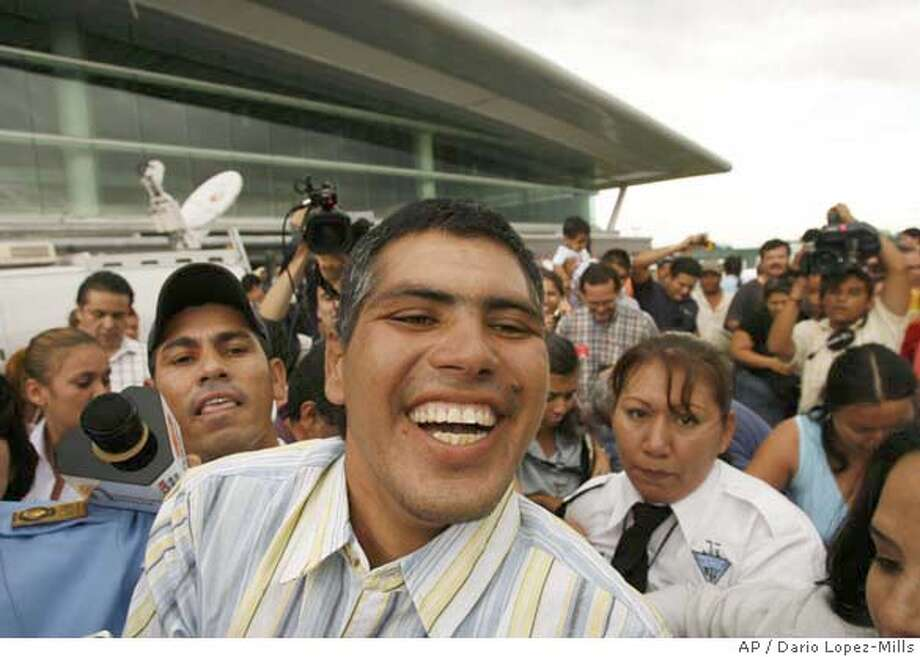 Mexican fisherman Jesus Vidana smiles as he leaves the airport upon arriving at his hometown of Culiacan, Mexico on Friday Aug. 25, 2006. Vidana is one the three fishermen that say they survived nine months adrift in the Pacific Ocean which returned to Mexico on Friday from 8,000 kilometers (5,500 miles) away to vehemently deny news media speculation that they were involved in drug trafficking or resorted to cannibalism to survive. (AP Photo/Dario Lopez-Mills) Photo: DARIO LOPEZ-MILLS