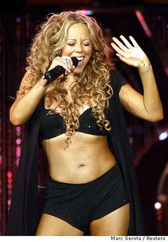 Singer Mariah Carey performs on the opening of her U.S. tour in Miami, Florida August 5, 2006. Picture taken August 5, 2006. REUTERS/Marc Serota (UNITED STATES) 0 Photo: MARC SEROTA