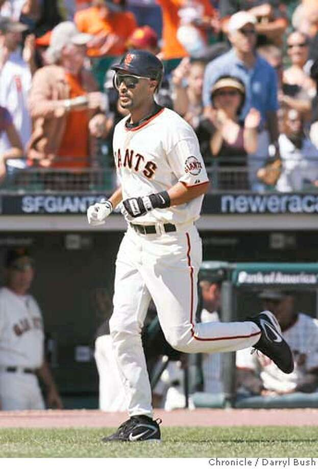 Giants Randy Winn runs to home plate after he doubled but went on to score on the same play because of a Cincinnati error in the 5th inning, San Francisco Giants vs. Cincinnati Reds at AT&T Park in San Francisco, CA on Saturday, August 26, 2006. 8/26/06  Darryl Bush / The Chronicle ** roster (cq) Photo: Darryl Bush