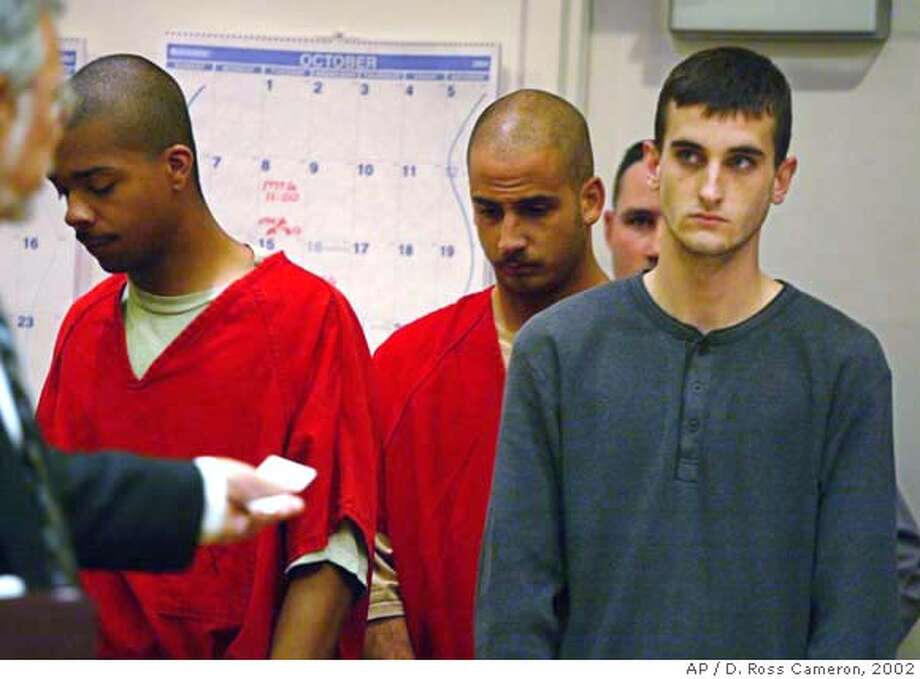 Jose Antonio Merel, left, Michael William Magidson, center, and Jaron Nabors are arraigned for the murder of 17-year-old Eddie Araujo of Newark, Calif., in Alameda Superior Court in Fremont, Calif., Friday, Oct. 18, 2002. (AP Photo/D. Ross Cameron) ALSO RAN 12/22/02 CAT Photo: D. ROSS CAMERON