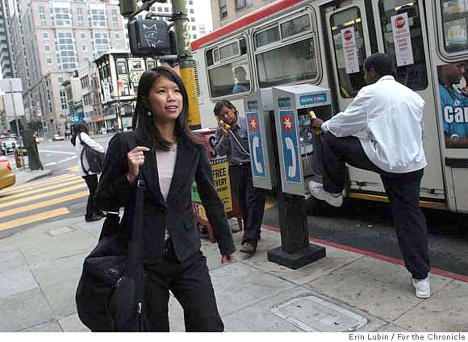 CHINA26_EAL_005.JPG  Karina Wong, author of My First Pot of Gold: An American Business Handbook for Chinese Immigrants walks along Kearny Street in San Francisco's Chinatown Friday morning, August 25, 2006. Wong, the daughter of Chinese immigrant entrepreneurs, is visiting the Bay Area to promote her new book. Event on 8/25/06 in San Francisco.  Erin Lubin / For the Chronicle MANDATORY CREDIT FOR PHOTOG AND SF CHRONICLE/ -MAGS OUT Photo: Erin Lubin
