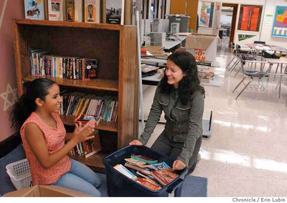 OAKSKULS_EAL_007.JPG  Marissa Cruz, 12, left, helps Humanities instructor, Nadia Behizadeh, right, organize books in Behizadeh's classroom at United For Success Academy, a new junior high school in Oakland, Friday, August 25, 2006. Cruz will be a seventh grader at Success and is in the math and science club for girls Behizadeh leads called Techbridge. United For Success is one of three new schools occupying the Calvin Simmons school campus. Event on 8/25/06 in Oakland.  Erin Lubin / For the Chronicle MANDATORY CREDIT FOR PHOTOG AND SF CHRONICLE/ -MAGS OUT Photo: Erin Lubin
