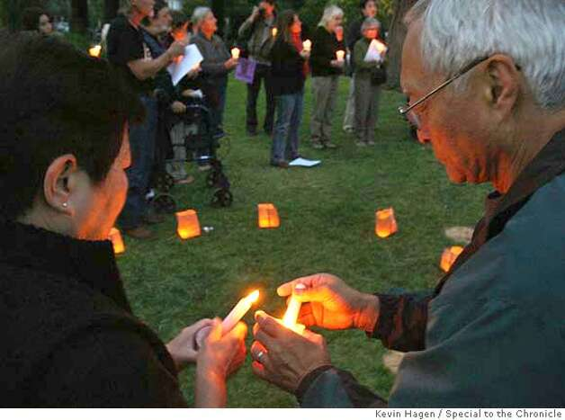 {HAMZA20_02} Bob Watada lights a candle for his wife Rosa Sakanishi during a vigil held to observe the birthday of slain Iraqi girl Abeer Hamza at Willard Park in Berkeley. Five soldiers are being charged for raping and then murdering the 14-year-old this March. By Kevin Hagen/SPECIAL TO THE CHRONICLE Photo: Kevin Hagen