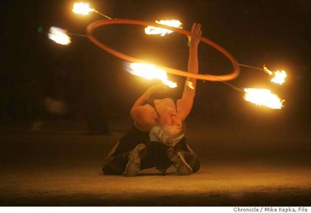 Tara Findley of the pyro troop, Radiant Heat, twirls fire on burn night. Saturday burn night on the Playa. burning man - burnman2005  Event on 9/3/05 in Black Rock City. Mike Kepka / The Chronicle Photo: Mike Kepka