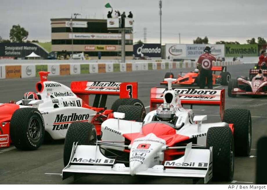 Sam Hornish Jr., right, and Penske teammate Helio Castroneves of Brazil, left, leave the pit area under a green flag for practice laps in preparation for the Indy Grand Prix of Sonoma Friday, Aug. 25, 2006, at Infineon Raceway in Sonoma, Calif. (AP Photo/Ben Margot) Photo: BEN MARGOT