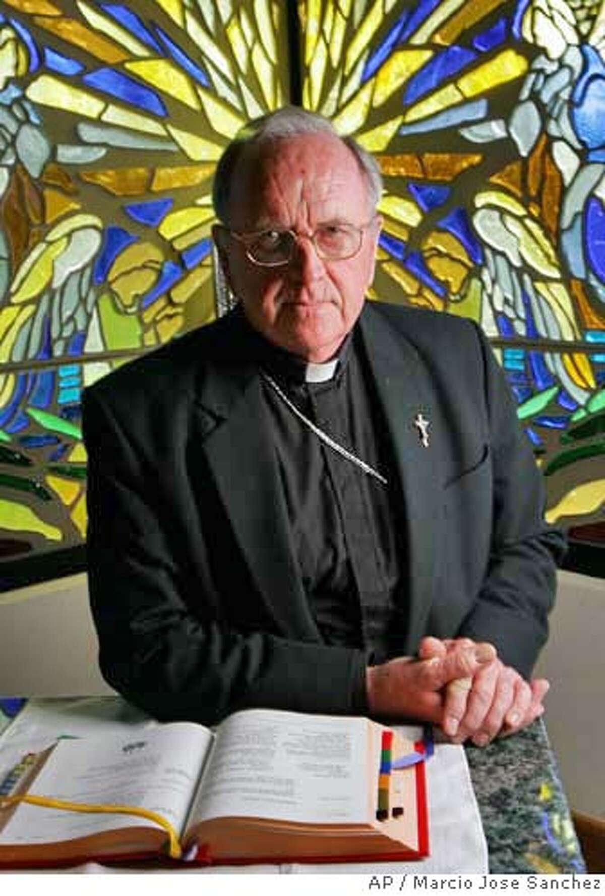 Bishop Daniel Walsh poses for a portrait in the chapel of the Santa Rosa Dioceses administrative office in Santa Rosa, Calif. on Tuesday, Aug. 15, 2006. Walsh could face criminal charges for his delay in reporting an admission of sexual abuse from a fellow priest. Authorities believe Walsh's delay allowed Rev. Xavier Ochoa to flee to Mexico. Ochoa faces 10 felony counts, including lewd acts with a child. (AP Photo/Marcio Jose Sanchez)