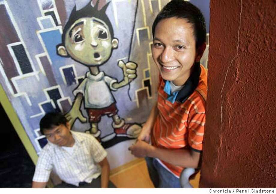 in a hallway just outside their studio are, at left, Bryan Pangilinan, Managing dir of Bindlestiff Studios, at rt interum exec dir. Alex Porres Bindlestiff Studios. The Studios, received a large grant for Filipino-American Arts. Event on 8/14/06 in San Francisco.  Penni Gladstone / The Chronicle  ***cq themselves MANDATORY CREDIT FOR PHOTOG AND SF CHRONICLE/ -MAGS OUT Photo: Penni Gladstone
