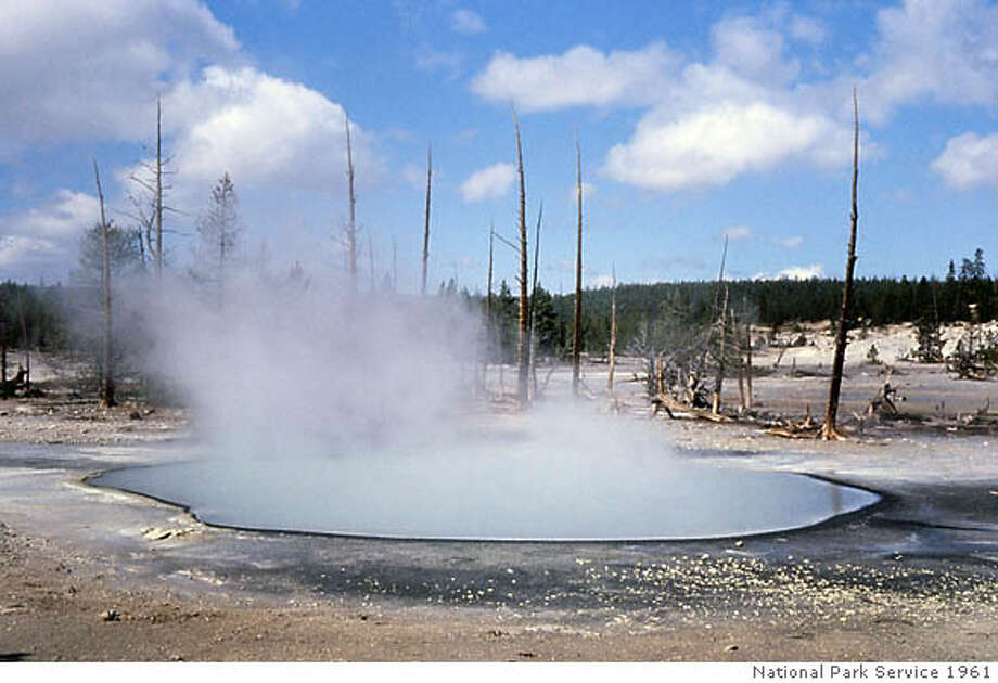 Cinder Pool, on the northern edge of Norris Geyser Basin, is only 20 feet across and is said to be the hottest pool in Yellowstone National Park. The black, smooth surface is pure iron sulfide. National Park Service photo, 1961