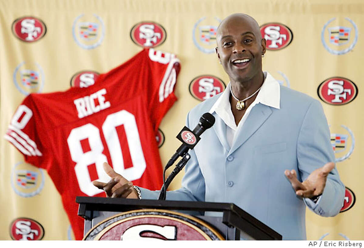 Wide receiver Jerry Rice smiles and answers questions after signing a one-day contract with the San Francisco 49ers during a press conference at the 49ers football headquarters in Santa Clara, Calif., Thursday Aug. 24, 2006. The 49ers will hold an official retirement ceremony for Rice at a game in November. (AP Photo/Eric Risberg)