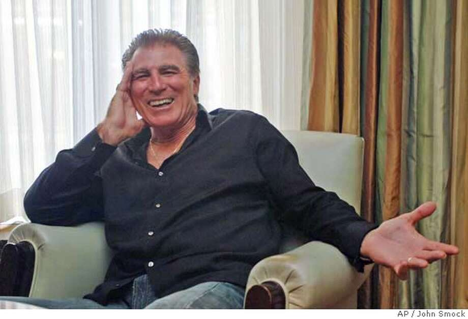 """Vince Papale, the real-life inspiration for the film """"Invincible,"""" poses during a visit to New York to promote the film Thursday, Aug. 17, 2006. A substitute teacher and bartender who never played college football, Papale tried out for the Philadelphia Eagles in 1976 and made the team at age 30, becoming the oldest rookie in National Football League history. That unlikely tale inspired """"Invincible,"""" starring Mark Wahlberg as Papale. (AP Photo/John Smock) Photo: JOHN SMOCK"""