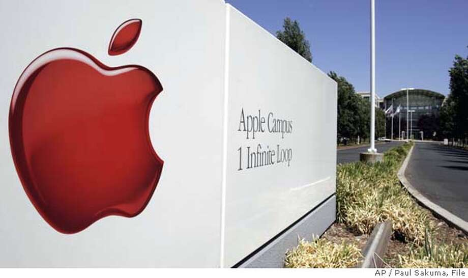 **FILE** The exterior view of Apple Computer headquarters in Cupertino, Calif., is seen in this Friday, Aug. 4, 2006 file photo. Apple Computer Inc. on Thursday recalled 1.8 million Sony-built notebook batteries that could overheat and catch fire, just 10 days after Dell Inc.'s record-setting recall involving the same problem and the same supplier. Apple said it has received nine reports of lithium-ion battery packs overheating, including two cases in which users suffered minor burns. There have been instances of minor property damage, Apple said. (AP Photo/Paul Sakuma, FILE) AN AUG. 4, 2006 FILE PHOTO Photo: PAUL SAKUMA