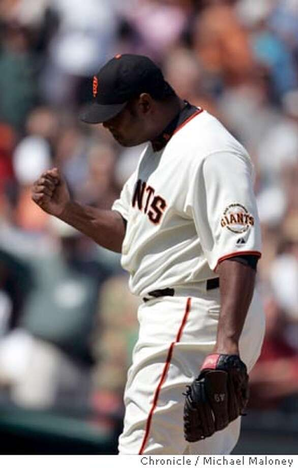 Closing piitcher Armando Benitez reacts with a fist after striking out Arizona's Enrique Gonzales to win the game.  SF Giants vs Arizona Diamondbacks at AT&T Park.  Photo by Michael Maloney / San Francisco Chronicle on 8/23/06 in San Francisco,CA Ran on: 08-24-2006  Armando Benitez makes a winning gesture as the Giants' closer completes sweep of D'backs.  Ran on: 08-24-2006  Armando Benitez makes a winning gesture as the Giants' closer completes sweep of D'backs. Photo: Michael Maloney
