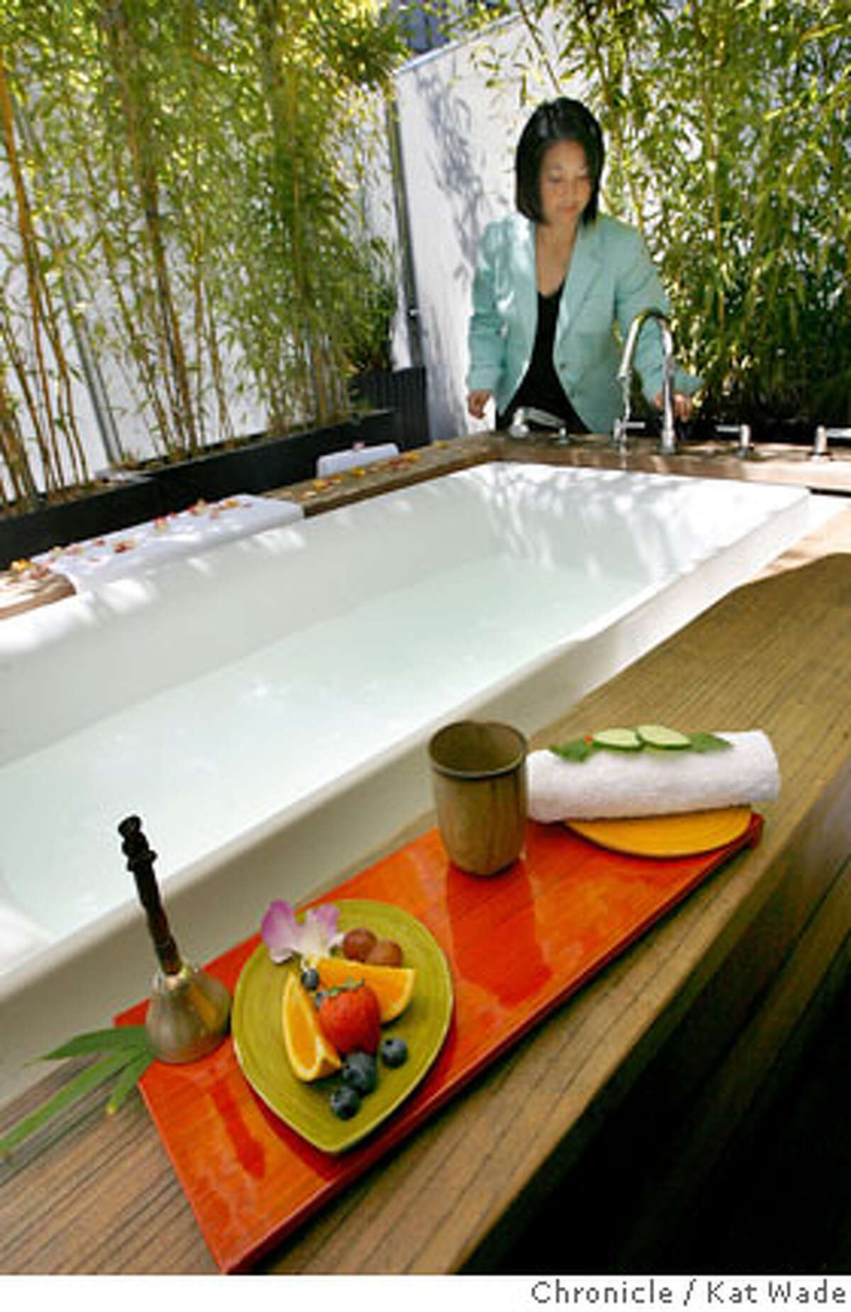 HOTELS_VITALE_108_KW_.jpg On Thursday August 17, 2006 Sharon Oshita, the Spa Vitale manager prepares the tubs on the roof surrounded by bamboo and pampering with an asian style at the Hotel Vitale on Mission Street at the Embarcadero. Kat Wade/The Chronicle **(Subject) cq