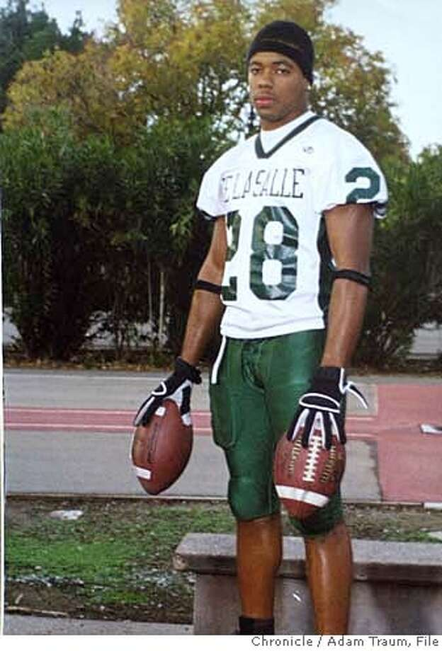 {060404_oakslay05_ckh) Copy photo of De LaSalle football star Terrance Kelly in his high school uniform. Richmond Police have already arrested the 18 year old Larry Pratcher of Richmond in the slaying of De LaSalle football star Terrance Kelly {08/16/04} in {Richmond}. {Adam Traum} / {SF CHRONICLE} Ran on: 08-20-2004  Darren Pratcher Ran on: 08-20-2004  Darren Pratcher  Ran on: 08-03-2006  Landrin Kelly stands in his Suisun City home amid mementos of his son, Terrance Kelly, a former De La Salle High School football star who was fatally shot in Richmond in 2004. Below right: A Sept. 27, 2003, article in The Chronicle about the game in which Kelly scored three touchdowns.  Ran on: 08-03-2006  Landrin Kelly stands in his Suisun City home amid mementos of his son, Terrance Kelly (below left), a De La Salle High School football star who was killed in Richmond in 2004. Below right: A Sept. 27, 2003, article in The Chronicle about the game in which Kelly scored three touchdowns.  Ran on: 08-03-2006  Landrin Kelly stands in his Suisun City home amid mementos of his son, Terrance Kelly (below left), a De La Salle High School football star who was killed in Richmond in 2004. Below right: A Sept. 27, 2003, article in The Chronicle about the game in which Kelly scored three touchdowns. Photo: Adam Traum