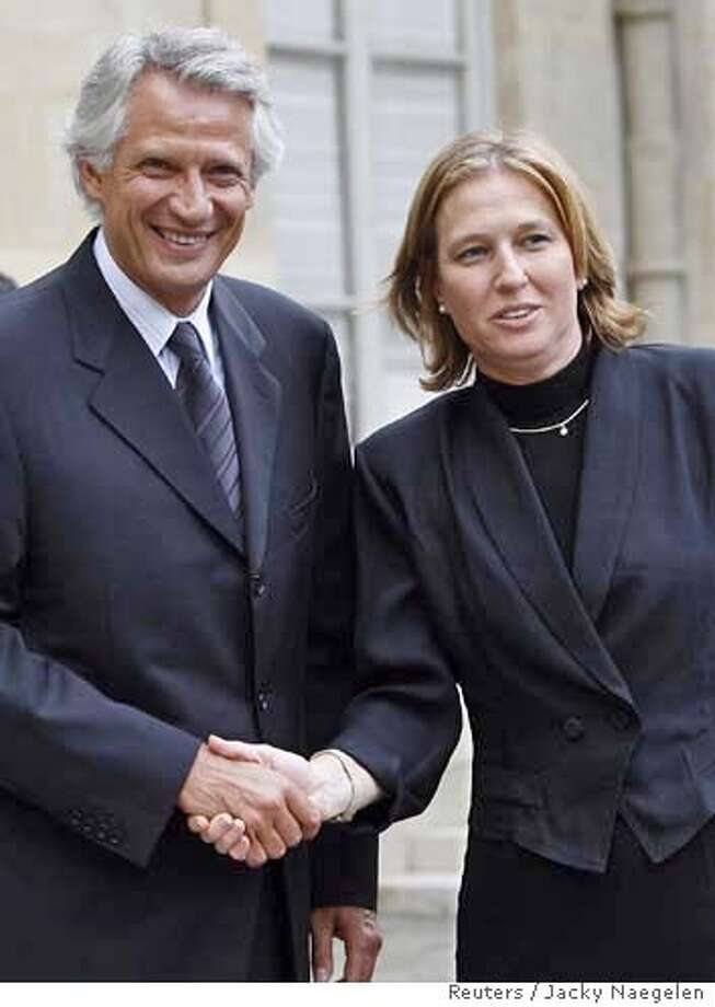 French Prime Minister Dominique de Villepin (L) shakes hand with Israeli Foreign Minister Tzipi Livni (R) after their meeting on the Middle East situation August 23, 2006 at the Hotel Matignon in Paris. REUTERS/Jacky Naegelen (FRANCE)  Ran on: 08-24-2006  Tzipi Livni, the Israeli foreign minister, urged rapid deployment of troops. Photo: JACKY NAEGELEN