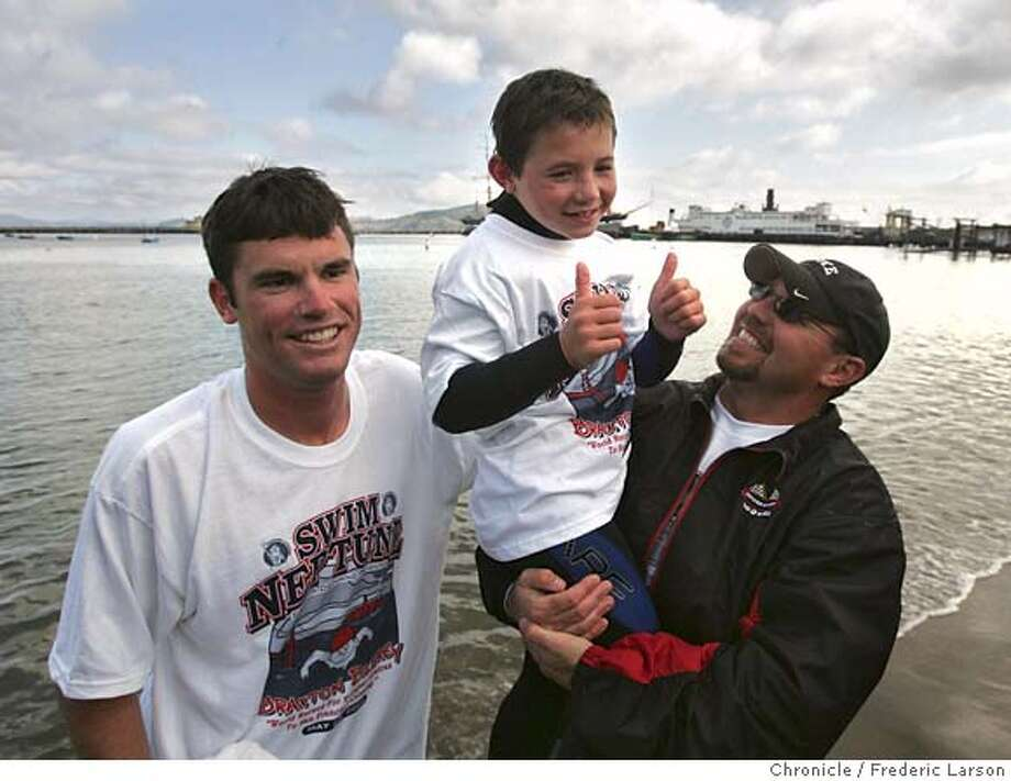 {object name} Braxton Bilbrey, 7, of Arizonia is all smiles standing next to his father Steve Bilbrey and his swim coach, Joe Zemaitis after he broke the record for the youngest person ever to swim from Alcatraz to San Francisco on Monday. Braxton is an average 7-year-old. He's a little over 4 feet tall and weighs about 65 pounds. He is, however, more muscular than most kids. Zemaitis said Braxton's focus was what made him believe the boy could handle the 1.4-mile swim through the cold water. Water temperature in the bay is about 55 degrees. The swimmers did wear wetsuits and took one hour and 13 minute to swim from the Alcatraz to beach of Aquatic park at Fisherman Wharf. ***Braxton Bilbrey, Steve Bilbrey and Joe Zemaitis  5/21/06  {Frederic Larson/The Chronicle} MANDATORY CREDIT FOR PHOTOGRAPHER AND SAN FRANCISCO CHRONICLE/ -MAGS OUT Photo: Frederic Larson