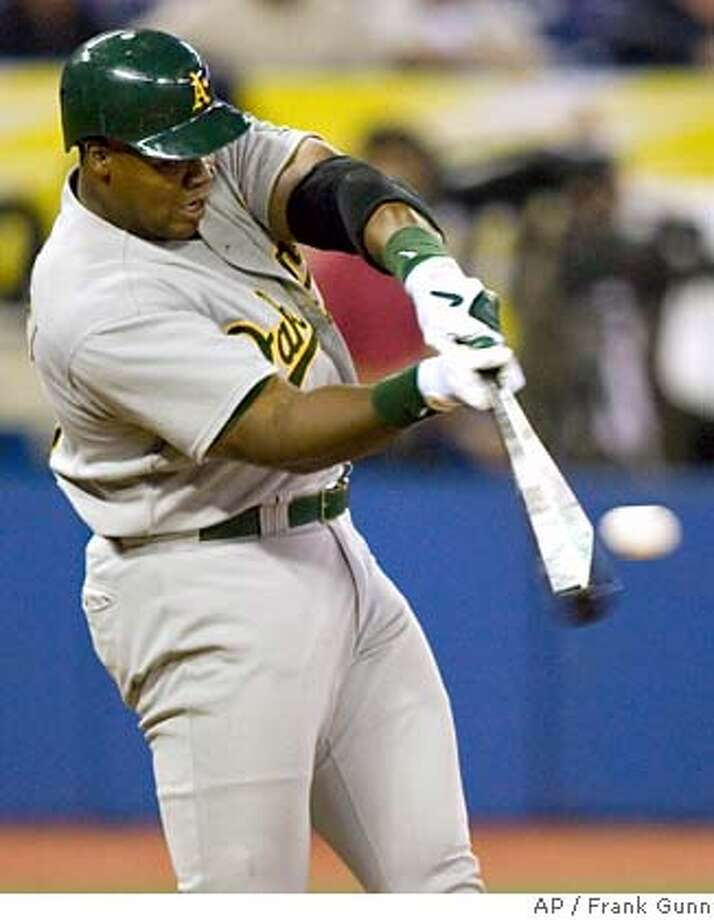 Oakland Athletics designated hitter Frank Thomas connects for a two run home run off Toronto Blue Jays starting pitcher Gustavo Chacin during first inning AL action in Toronto on Wednesday Aug. 23, 2006. (AP PHOTO/CP, Frank Gunn) Photo: FRANK GUNN