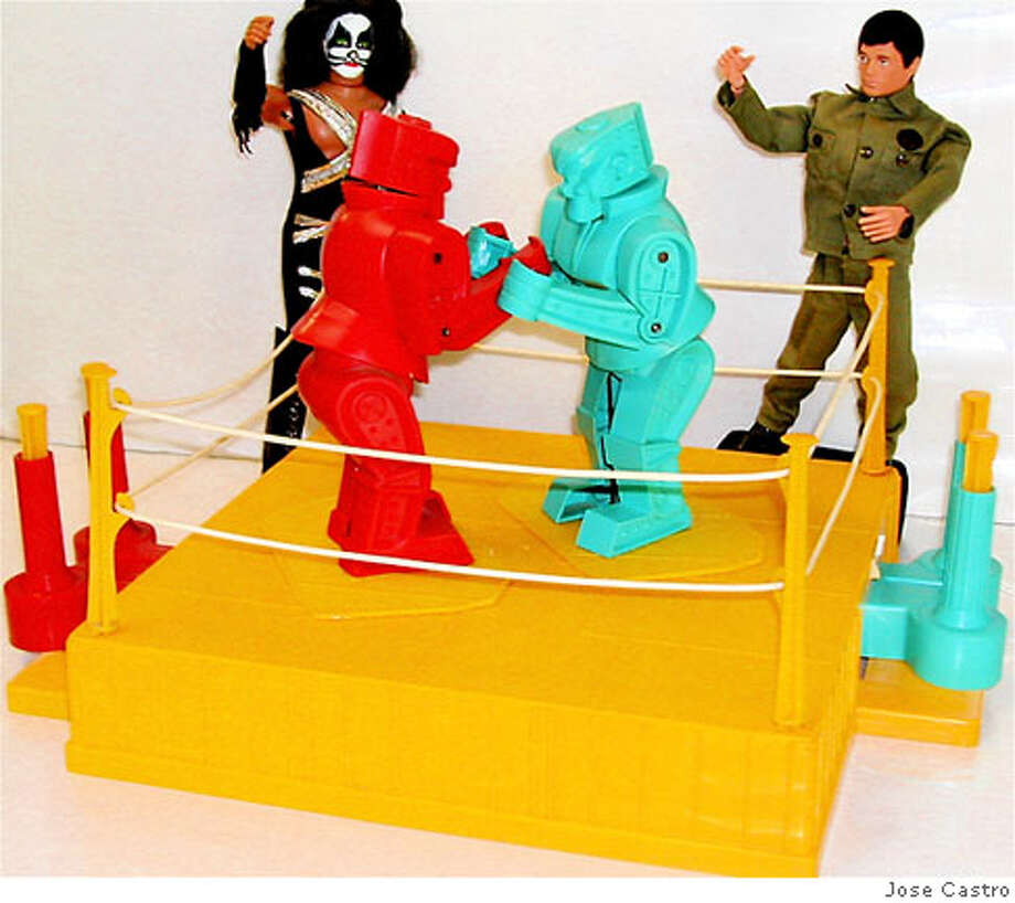 "The boxing toy photo is the ""ROCK EM SOCK ROBOTS"" (from the 1960's) the character to the left with face painting is ""PETER CRISS"" from  the rock group KISS (the toy is by MEGO from the 1970's). Also it has GI JOE from the 1970's. The red and silver robot is ""ULTRAMAN"" and of course a GODZILLA TOY from Japan by the Bandai toy company. Credit: Jose Castro Photo: Jose Castro"