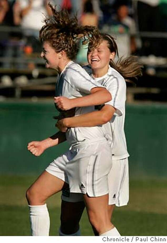ncaasoccer_213_pc.jpg  Santa Clara's Jordan Angeli (left) is hugged by teammate Tiffany Roberts after her goal put the Broncos ahead for good in the second half. The Santa Clara Broncos beat the Boston College Eagles 2-1 in the third round of the NCAA women's soccer tournament on 11/19/05 in Santa Clara, Calif. and advance to the quarter-final round.  PAUL CHINN/The Chronicle MANDATORY CREDIT FOR PHOTOG AND S.F. CHRONICLE/ - MAGS OUT Photo: PAUL CHINN