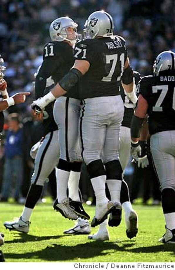 raiders_286_df.JPG  Sebastion Janikowski celebrates a field goal with Corey Hulsey. Oakland Raiders lose to the Miami Dolphins 33-21 at McAfee Coliseum.  Event in Oakland on 12/27/05.  Deanne Fitzmaurice / The Chronicle Photo: Deanne Fitzmaurice