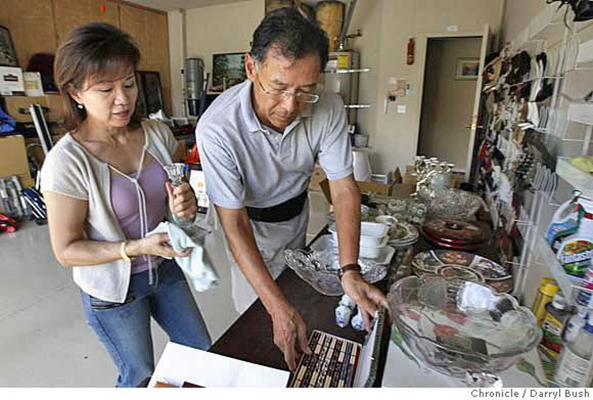 chinahouse_0006_db.JPG Married couple Philip Hu and Tanlie Chao prepare some of their belongings for a garage sale at their home in San Jose, CA on Wednesday, August 23, 2006. Hu and Chao are moving to China. 8/23/06 Darryl Bush / The Chronicle ** Philip Hu, Tanlie Chao (cq) MANDATORY CREDIT FOR PHOTOG AND SF CHRONICLE/ -MAGS OUT